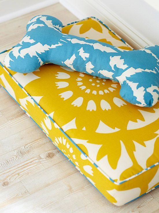 Bright modern Dog Bed with massive bone-shaped pillow