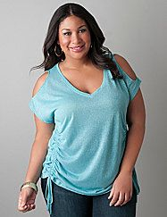 Cold shoulder cut-outs, drawstring-shirred sides and a V-neckline flatter what matters on this sheer top by DKNY JEANS. Lightweight jersey infused with metallic threads makes an eye-catching statement dressed up or down. Short sleeves.  lanebryant.com
