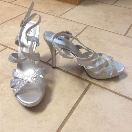 Fioni Evening Heels Silver, worn once, a little bit of puppy chewing on the one heel, shown in photo, other than that they are in like new condition! Fioni Shoes Heels