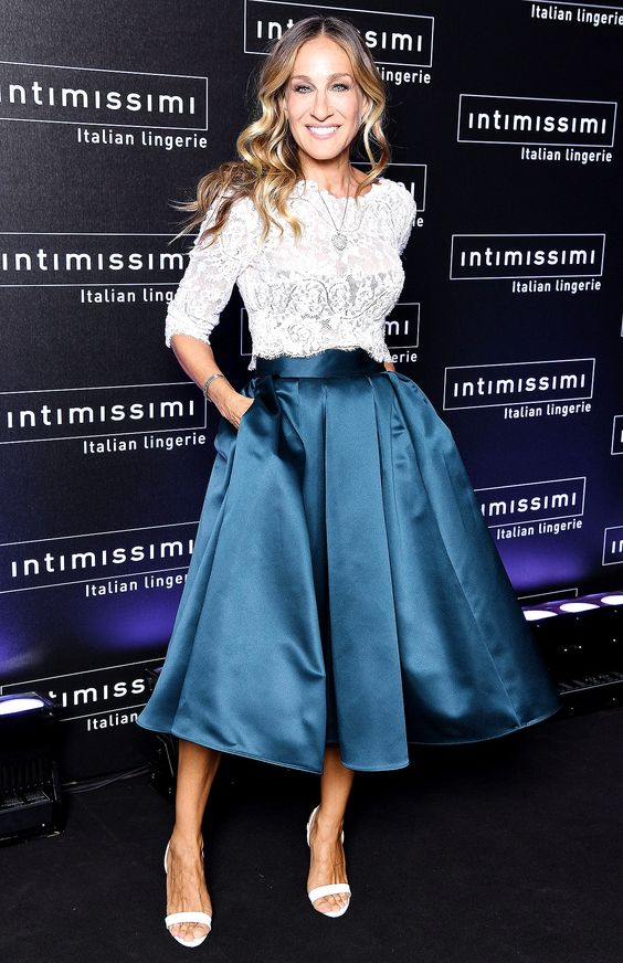 Sarah Jessica Parker in a white lace top, a navy skirt and white sandals at the Intimissimi show in Verona, Italy.