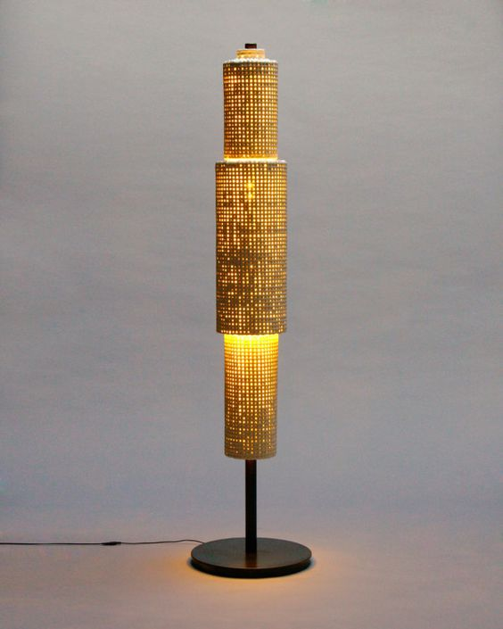 the floor light from the Cmesh Collection by Brooklyn-based Scott Daniel.  ceramic and mesh. This one looks like a skyscraper at dusk.