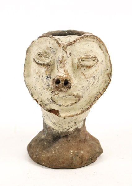 Papua New Guinea, Aibom Village, Chambri Lakes (Sepik Region) effigy figural pottery handle-less vessel (or possibly, sago pot) with white painted heart shaped sculpted face with almond form eyes, nose with two circular nostrils and oblong mouth on a circular foot.