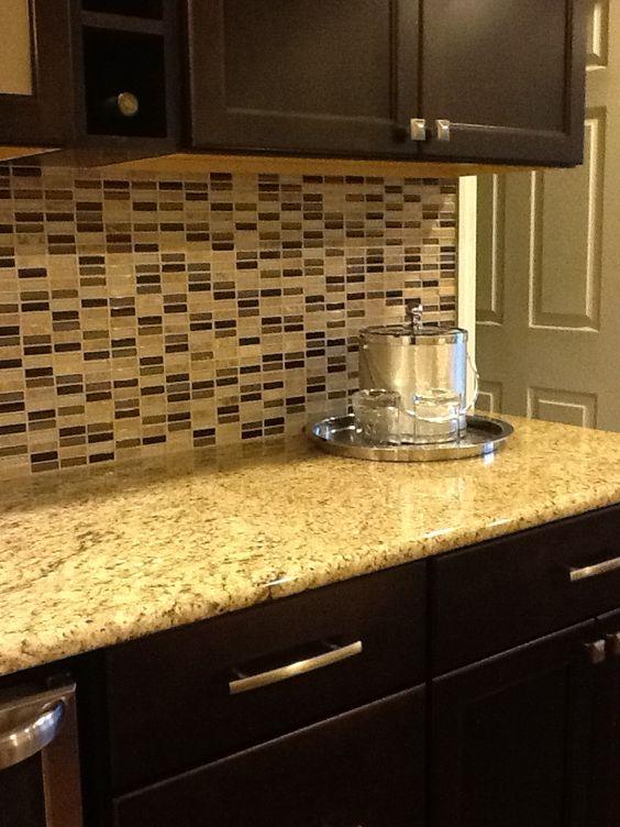 Glass tile backsplash, Venetian Gold granite countertop, chocolate cabinets