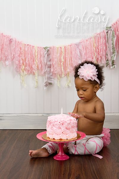 cake smash photographer in winston-salem, nc | baby photographers in high point, clemmons, greensboro | birthday photography and one year mini sessions | colorful hot pink fuschia  theme birthday party ideas tutu flower diaper cover rosette cake banner bunting