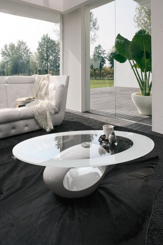 Dubai Coffee table with marble conglomerate  base and tempered glass top. Available also with the base in any RAL color, to customize your ambient as you wish. Dubai is the only original, with deposited patent.