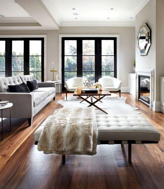 oak floors, tufted leather seating + industrial black window panes...