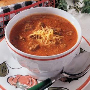 """Quick Pizza Soup...This gets a 6 thumbs-up rating from our family when we have chopped pepperoni and shredded mozzarella cheese as toppings. I often serve Butter-dipped Biscuit Squares (cut into """"fingers"""" rather than squares before baking) or garlic bread and sometimes a salad with it.  Yummy to the tummy!"""