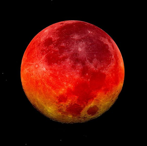 Look for the Blood Red Moon on April 15/16, 2014.  The total lunar eclipse arrives just after midnight on April 15. The bloody red color the moon takes on during an eclipse is caused by refraction of sunlight by the Earth's atmosphere.  April 15th's red moon begins a rare sequence of four total lunar eclipses expected over the next two years!!