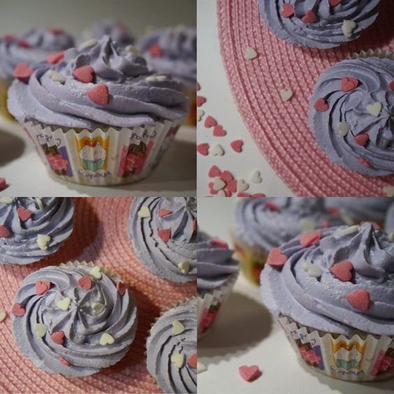 Homemade vanilla cupcakes with bilberry filling and extremely delicious curd cream on the top