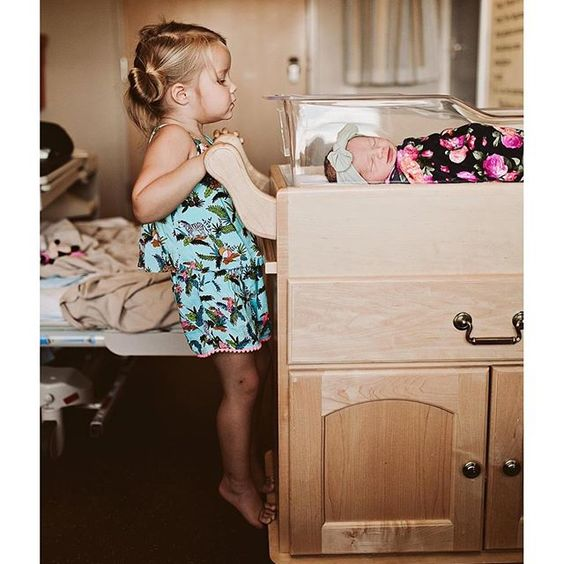 Sweetest sibling picture. With our navy blue floral swaddle.