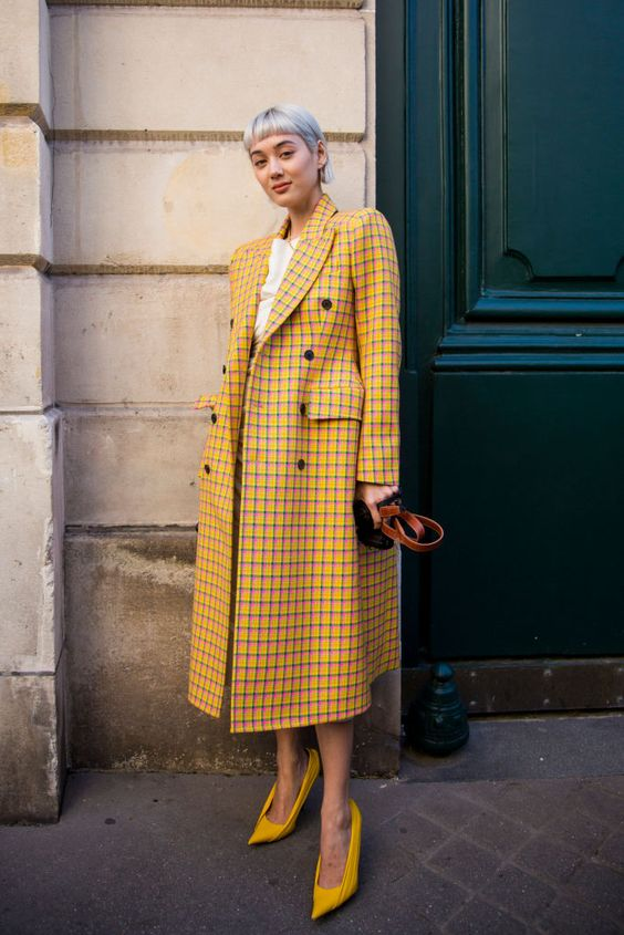 PARIS, FRANCE - SEPTEMBER 24: Kim Jones wearing yellow checked coat, is seen after the Jacquemus show, on September 24, 2018 in Paris, France. (Photo by Claudio Lavenia/Getty Images)
