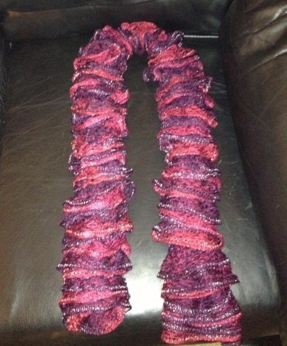 Ruffle scarf made on 8peg spool loom with red heart sashay yarn