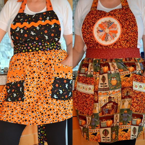 Halloween Apron.  Thanksgiving Apron.  Reversible Apron for two holidays. 100% cotton fabric.  Vintage, hand sewn Dresden Plate pot holder. Giant Rick Rack.  Ribbon embellishments.  One of a Kind Reversible Apron.  Donated to Caroline's Non Profit Thrift Shop.  #Reversible   #Apron