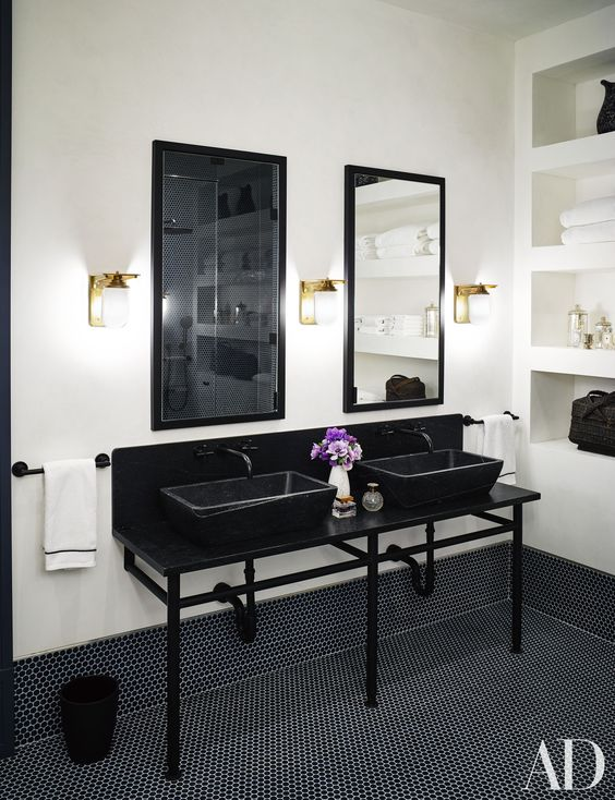 Ashe + Leandro designed the black and white master bath's washstand sinks in Naomi Watts and Liev Schreiber's stunning New York City apartment.
