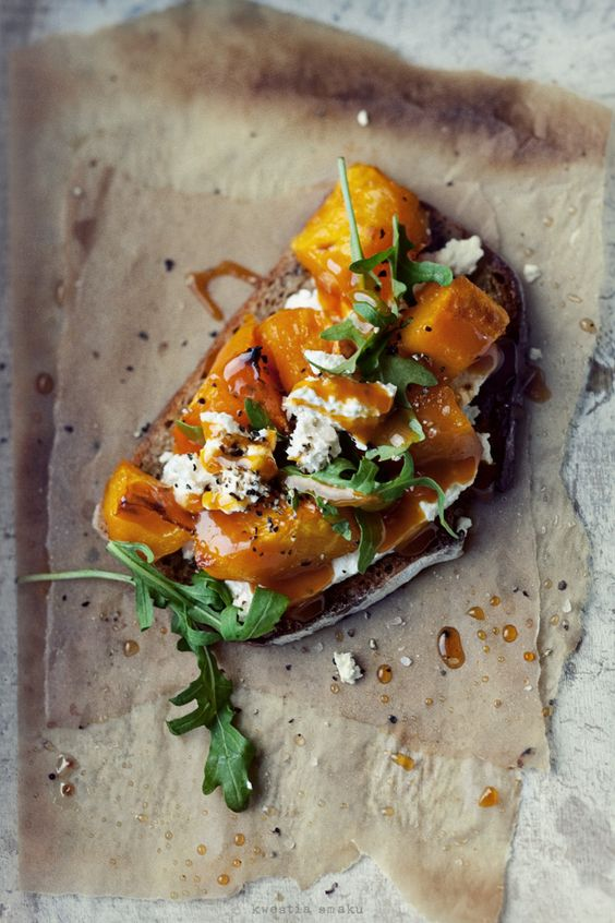bruschetta with roasted pumpkin, white cheese and rocket salad
