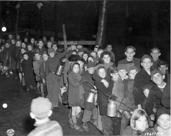 French children eagerly waiting to receive food rations.