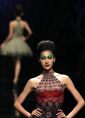 A model wears a design created for the Deng Hao Haute Couture fashion show during China Fashion week held in Beijing Monday, Oct. 31, 2011. (AP Photo/Ng Han Guan)