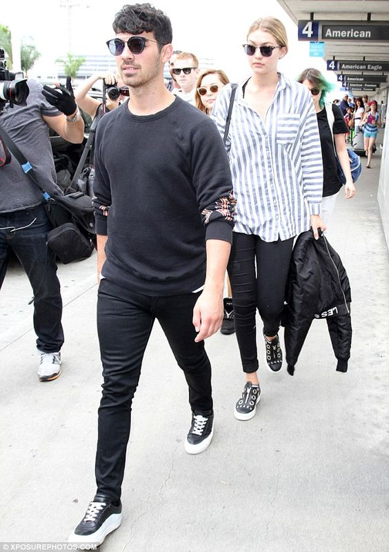 Just the two of us: Joe, 25, rocked an all-black look including sweater, jeans and leather...
