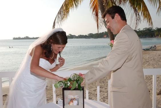 unity sand ceremony. pouring the sand into a picture frame, great for keepsake after the wedding.