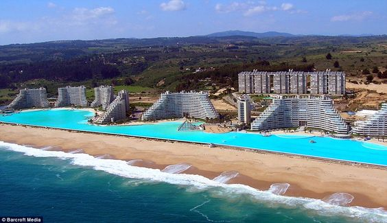 A little slice of the Pacific: The world's biggest pool is three fifths of a mile long and draws water from the ocean, cleaning it and allowing the sun to warm it to 26C