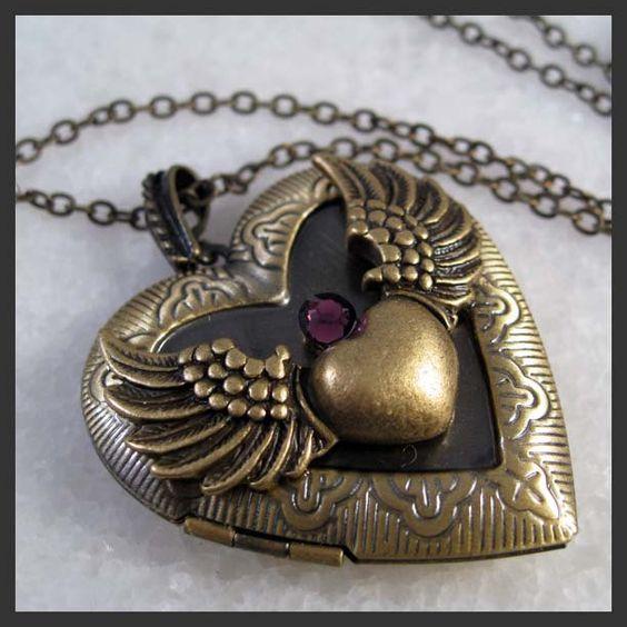 Angel Wing Locket Necklace With Swarovski Amethyst Crystal Brass Heart Pendant. $12.50, via Etsy.