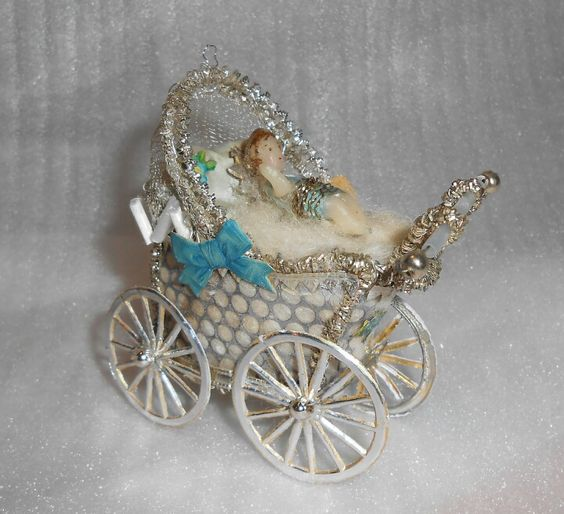 Sebnitz Baby Carriage with wax baby, scraps, Dresden trims, glass beads, and fancy German wires. By Betsy Browning