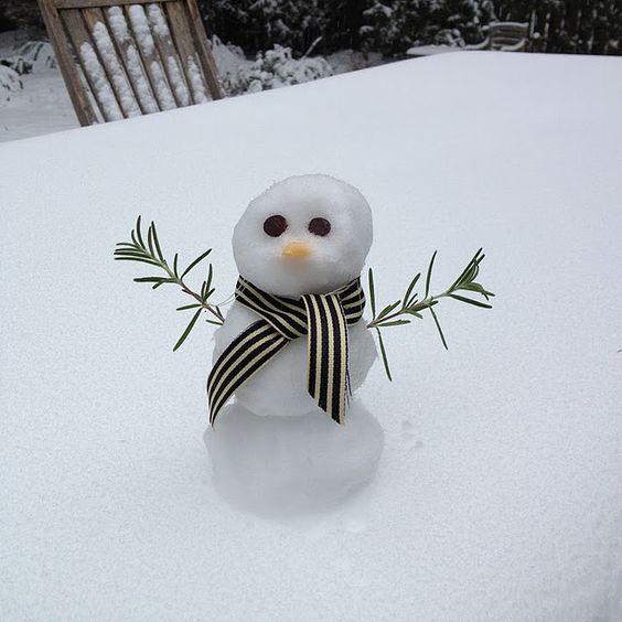 Make a mini snowman. Pebbles, buttons, ribbons, twigs, etc