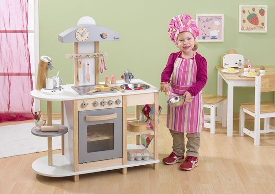 """Süße Spielküche aus Holz, teilweise lackiert in natur-weiss-edelstahlfarbig. Ausgestattet mit Cerankochfeld, Spüle, Dunstabzug, Backofen, Drehkarusell. Drehknöpfe mit """"Klick"""". Incl. 2 Topflappen und Handtuch,(ohne Dekoration) Arbeitshöhe 55 cm."""