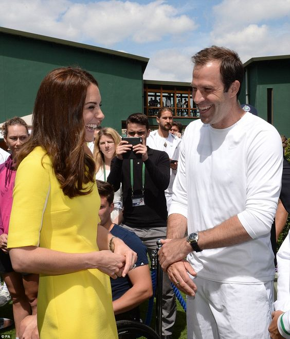 The Duchess of Cambridge meets British tennis star Greg Rusedski who played for Canada before his retirement in 2007 during a visit to the Lawn Tennis Championships