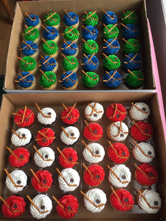 DIY hockey cupcake decorations - each team color from my daughter's Termites age group is represented for their end of season party