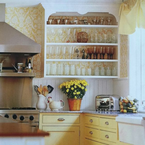 Happy yellow kitchen cabinetry - yellow + white wallpaper - apron front sink