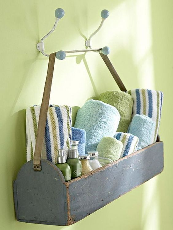 Got an old wooden tool box that you're not using? Put it to work in your bath, storing towels and sundries.