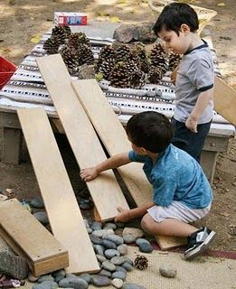 """Love this play philosophy of adding """"loose parts"""" to the yard.  Want to get a collection of boards, blocks, """"tree cookies"""" and other natural items for our yard this summer!"""