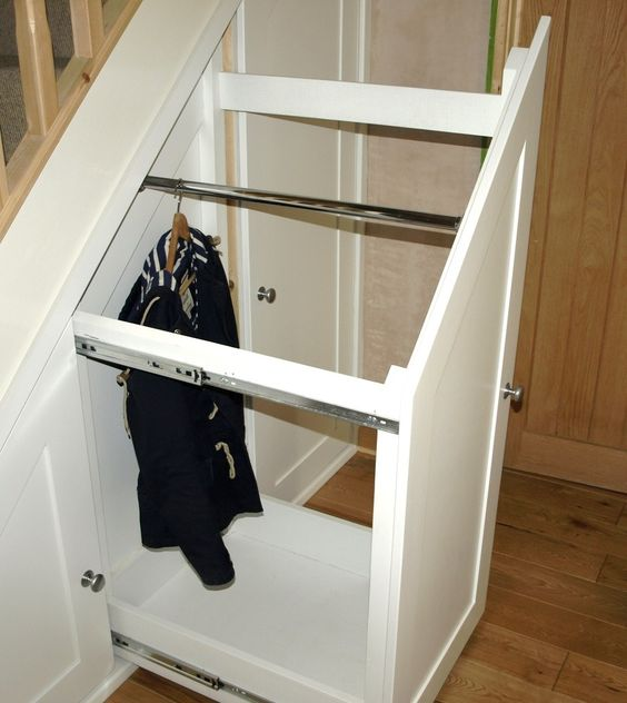 Decoration, Innovative Sliding Storage Under Stairs With White Walk In Closet And Wooden Stair. Could be great for storing coats out of sight!