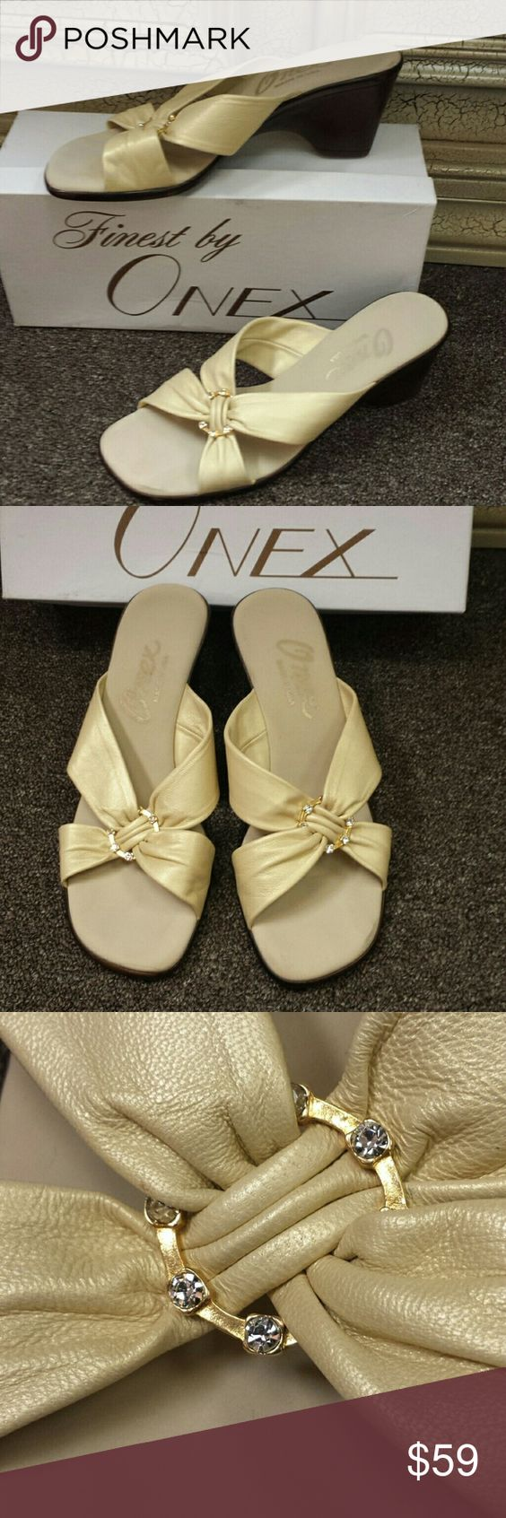 Onex gold leather sandals Onex gold leather sandals with gold and rhinestone embellishments never worn .  Stylish and comfortable onex Shoes Sandals