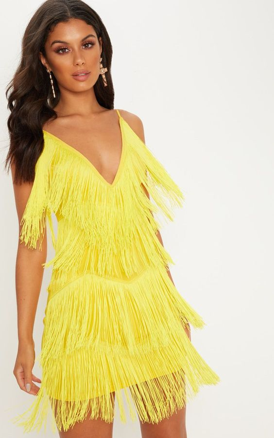 Yellow Strappy Plunge Tassel Bodycon DressGet ready to party in this insane bodycon dress. Featu...