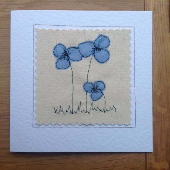 These simple but delicate flowers were made by sewing organza onto a canvas background. The finished result is similar to that of a painted picture but far more special and unique. The needle was my pen and the fabric was my paint. This card would shine out from any others in a line up. It would be perfect for framing as a special memento to keep long after the event. Each card is individually handmade by me in my studio so small variations from the one in the photo make it uniquely special. ...