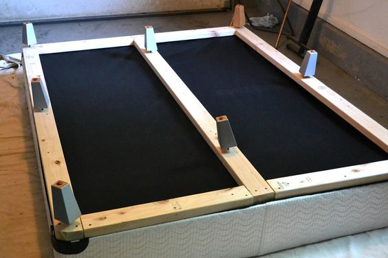 add boards to bottom of box spring cover in fabric and add some legs for a new bed frame to. Black Bedroom Furniture Sets. Home Design Ideas