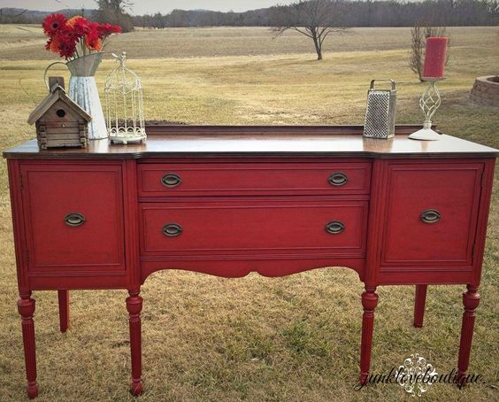 Antique buffet//sideboard painted Posh Red with a Walnut stained top. The color is intensified with Annie Sloan waxes. Available $550.