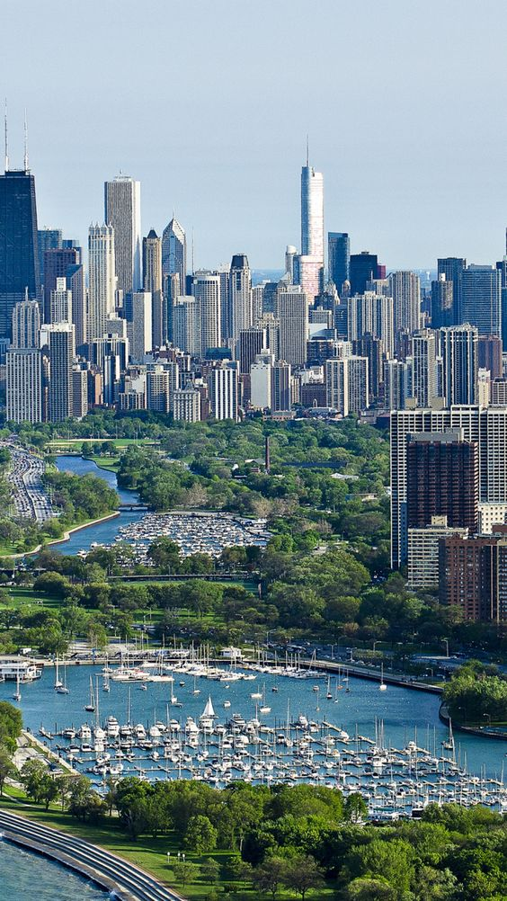 Chicago, skyscrapers, Belmont and Diversery harbors. The lake is in the bottom left corner.: