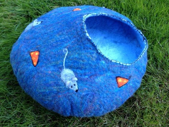 Felted Cat Cave by Terri Brigham is an example of a whimsical cat bed you could make for your feline friend.: