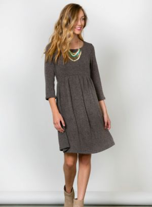 Gorgeous quality and ultimate versatility combine in the Catie Sweater Dress! This closet staple features fitted 3/4 sleeves and a flattering elasticized waist band in an unbelievably soft sweater material.