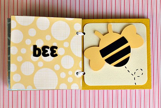 This blog post highlights the new Quiet Book cartridge from Cricut. Use these images as inspiration to create Quiet Books using any images from other cartridges. These would be adorable done in fabric and would make great toddler gifts!