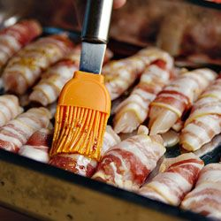 The best snack ever! Chicken strips wrapped in bacon and lightly brushed with a honey mustard marinade. Easy step by step photo directions!