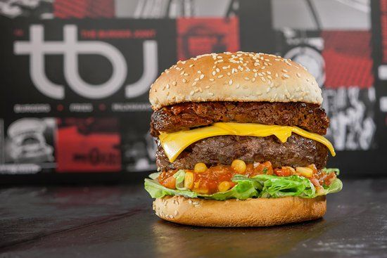 Famous For Its Mouthwatering Gourmet Burgers The Burger Joint Tbj Serves The Best Burger On Duba Burger Joints Burger Good Burger