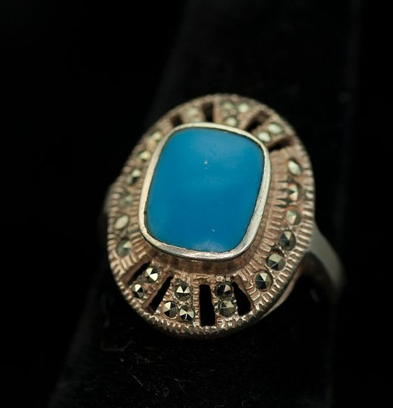 Lovely Art Deco style sterling ring set with marcasites and a turquoise blue stone. Size 5.5 - 6 No clear identifying markings, stamped 925