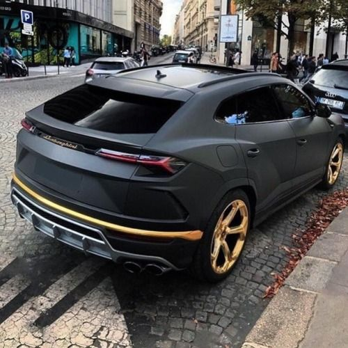 Matte Black Lamborghini Urus with gold accents
