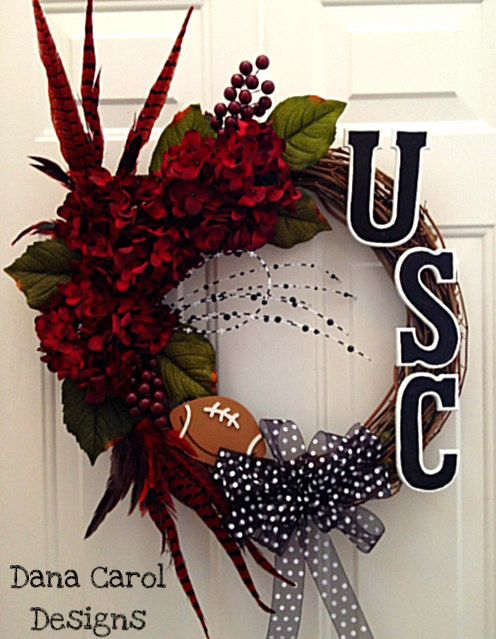 South Carolina Gamecocks Football Wreath or by DanaCarolDesigns dont care much for the football part but the feathers and floral is very inspirational