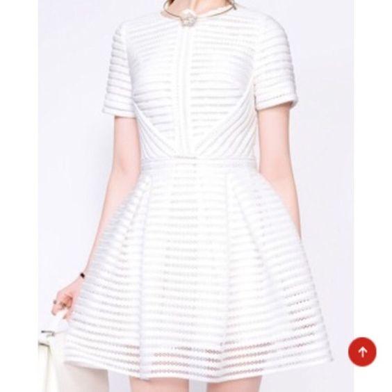 Sheer White Dress White sheer short sleeve high waist dress. NOTE: Dress runs small, will fit a 6-8. NO TRADES/NO PAYPAL Dresses