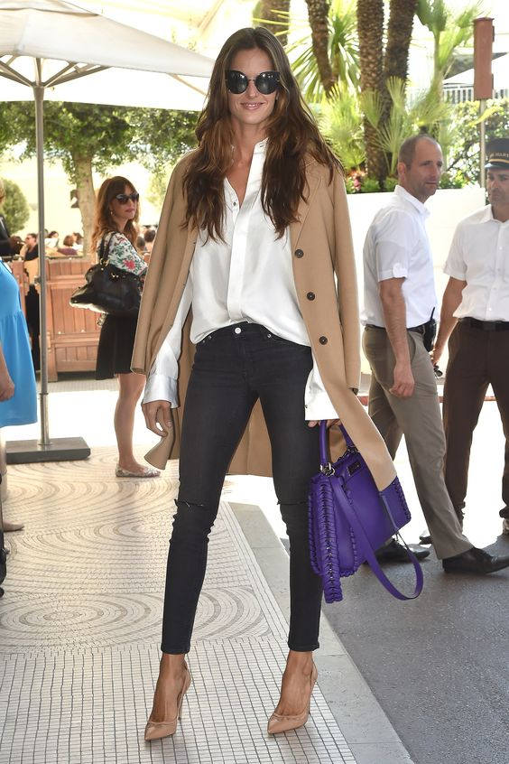 Model Izabel Goulart, 31, flaunted her endless legs in simple gray skinnies and elongating nude pumps. A crisp white shirt and camel top coat were effortlessly chic. (Photo by Jacopo Raule/GC Images) via @AOL_Lifestyle Read more: http://www.aol.com/article/2016/05/16/sexy-stars-j-lo-kourtney-kardashian-and-more-wow-in-white/21378350/?a_dgi=aolshare_pinterest#fullscreen